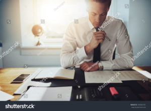 stock photo serious business man working on documents looking concentrated with briefcase and phone on the table 339364181 2 300x220 - stock-photo-serious-business-man-working-on-documents-looking-concentrated-with-briefcase-and-phone-on-the-table-339364181-2